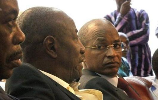 Guinea Presidential candidates Cellou Dalein Diallo, right, and Alpha Conde, left, wait for Interim President  Sekouba Konate to speak in Conakry, Guinea, Saturday Nov. 6, 2010, on the eve of the long delayed second round of presidential elections scheduled for Sunday Nov. 7, 2010. June's first round of voting was relatively peaceful.  The second-round run-off was delayed over legal challenges to the results of that vote, then delayed again  after violence between Diallo and Conde supporters.(AP Photo/Jerome Delay)