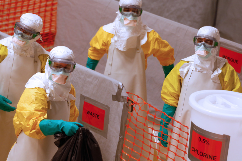 Medical workers wearing protective suits take part in a training prior to leave to countries affected by the Ebolas virus, in an empty factory warehouse in Amsterdam, on November 5, 2014 where medicals aid group Medecins Sans Frontieres (MSF) created a mock clinic. The disease has killed nearly 5,000 people, almost all of them in Sierra Leone, Liberia and Guinea. AFP PHOTO/ANP/BAS CZERWINSKI-netherlands out-