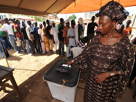 A woman casts her vote at a polling station in Conakry on November 7, 2010. Guineans will elect a civilian president in the country's first democratic vote in more than 50 years, in a run-off race that has pitted the two main ethnic groups against each other, resulting in mistrust and violent clashes. AFP PHOTO / ISSOUF SANOGO (Photo credit should read ISSOUF SANOGO/AFP/Getty Images)